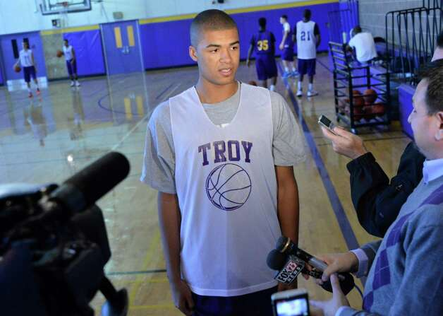 Troy High basketball player Javion Ogunyemi announces his plans to play for Siena next season during practice at the school Friday Nov. 9, 2012.  (John Carl D'Annibale / Times Union) Photo: John Carl D'Annibale / 00020058A