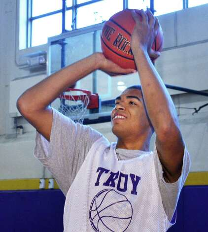 Troy High basketball player Javion Ogunyemi during practice at the school Friday Nov. 9, 2012. Ogunyemi has announced that he plans to play for Siena next season.  (John Carl D'Annibale / Times Union) Photo: John Carl D'Annibale / 00020058A