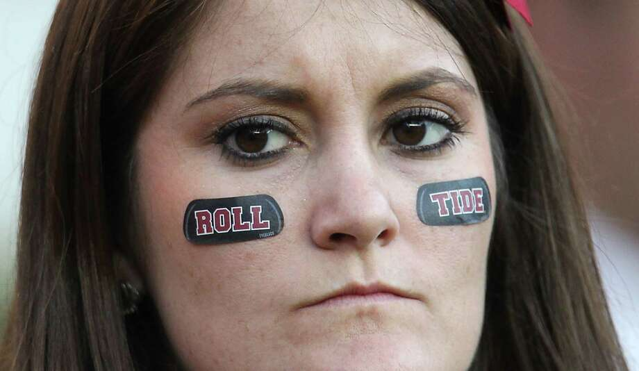 With Alabama back in the national title game, plenty of college football fans will watch Monday, hoping the Crimson Tide faithful reprise the disappointment they experienced during a loss to Texas A&M. Photo: Karen Warren, Staff / © 2012  Houston Chronicle