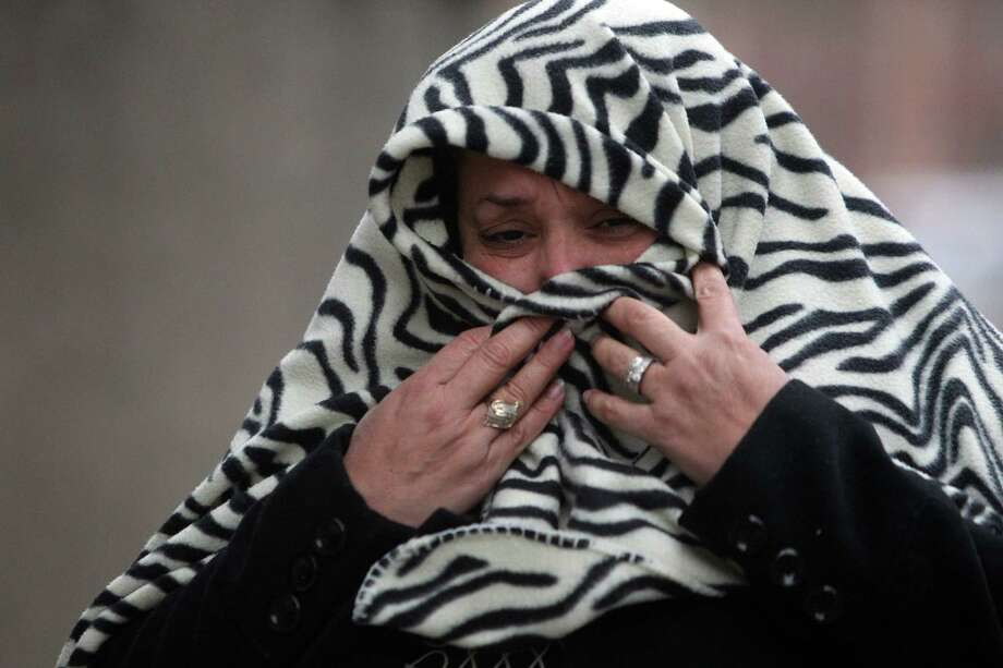 Roxanne Chavarria walks through downtown weathering the cold as the Houston area continues to experience low temperatures on Wednesday, Jan. 2, 2013, in Houston. Photo: Mayra Beltran, Houston Chronicle / © 2012 Houston Chronicle