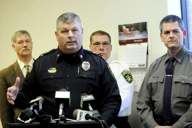 Hudson Falls Police Chief Randy Diamond, second from left, speaks during a news conference on Wednesday, Jan. 2, 2013, at Hudson Falls Village Hall in Hudson Falls, N.Y. Thousands of pieces of stolen property have been recovered. Joining Diamond, from left, are Washington County District Attorney Kevin Kortright, Washington County Sheriff Jeff Murphy and State Police Lt. John Durling. (Cindy Schultz / Times Union) Photo: Cindy Schultz / 00020629A
