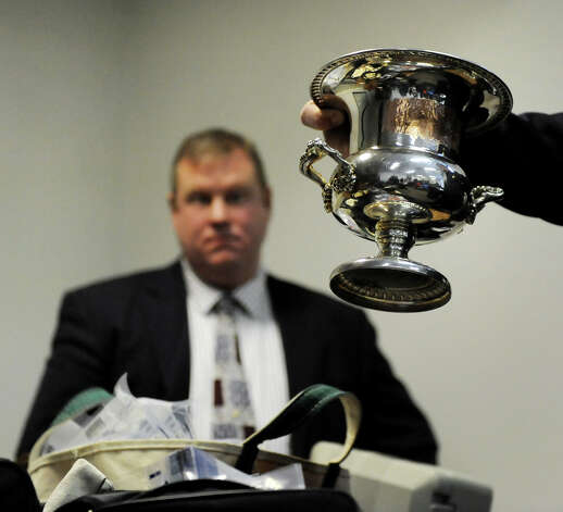 A silver chalice is one of thousands of recovered pieces of stolen property during a news conference on Wednesday, Jan. 2, 2013, at Hudson Falls Village Hall in Hudson Falls, N.Y. At left is Detective Scott Gillis. (Cindy Schultz / Times Union) Photo: Cindy Schultz / 00020629A