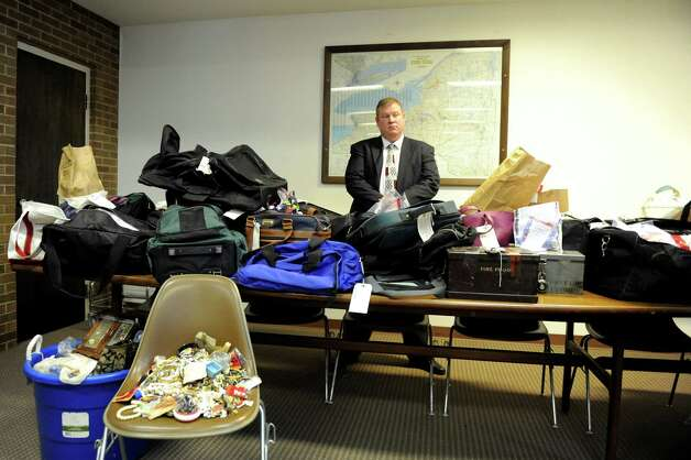 Detective Scott Gillis stands behind thousands of recovered pieces of stolen property during a news conference on Wednesday, Jan. 2, 2013, at Hudson Falls Village Hall in Hudson Falls, N.Y. (Cindy Schultz / Times Union) Photo: Cindy Schultz / 00020629A