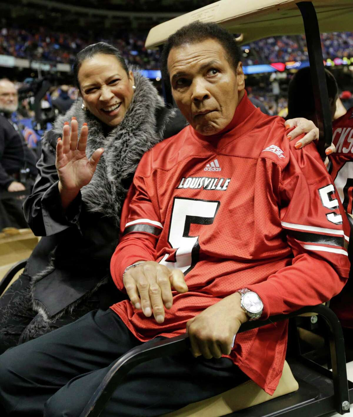 Former boxing legend Muhammad Ali arrives for the coin toss prior to the start of the Sugar Bowl NCAA college football game between Florida and Louisville on Wednesday, Jan. 2, 2013, in New Orleans. (AP Photo/Dave Martin)