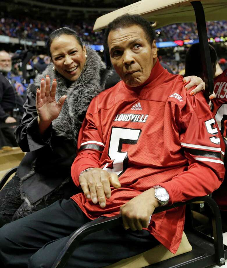 Former boxing legend Muhammad Ali arrives for the coin toss prior to the start of the Sugar Bowl NCAA college football game between Florida and Louisville on Wednesday, Jan. 2, 2013, in New Orleans. (AP Photo/Dave Martin) Photo: Dave Martin, Associated Press / AP