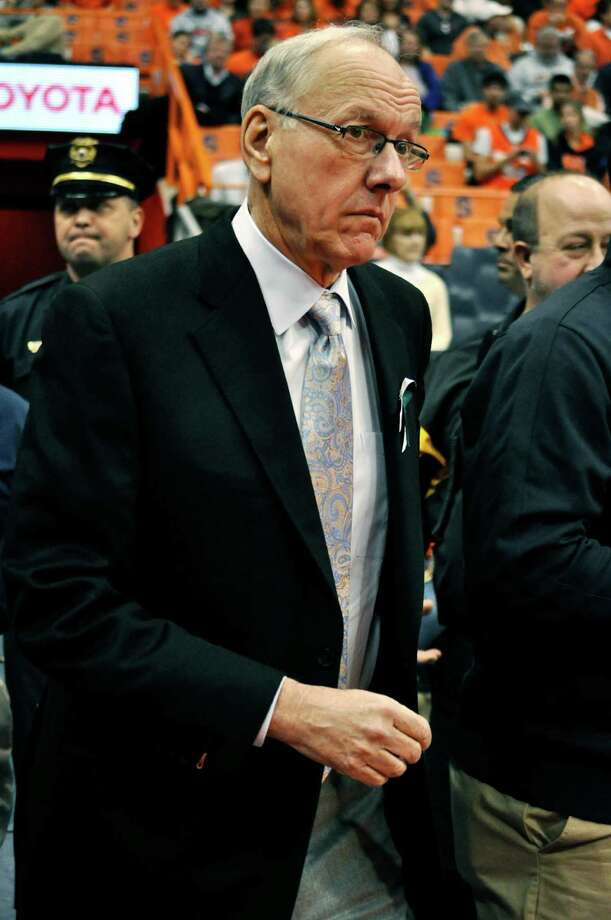 Syracuse head coach Jim Boeheim walks onto the court before an NCAA college basketball game against Rutgers in Syracuse, N.Y., Wednesday, Jan. 2, 2013. (AP Photo/Kevin Rivoli) Photo: KEVIN RIVOLI