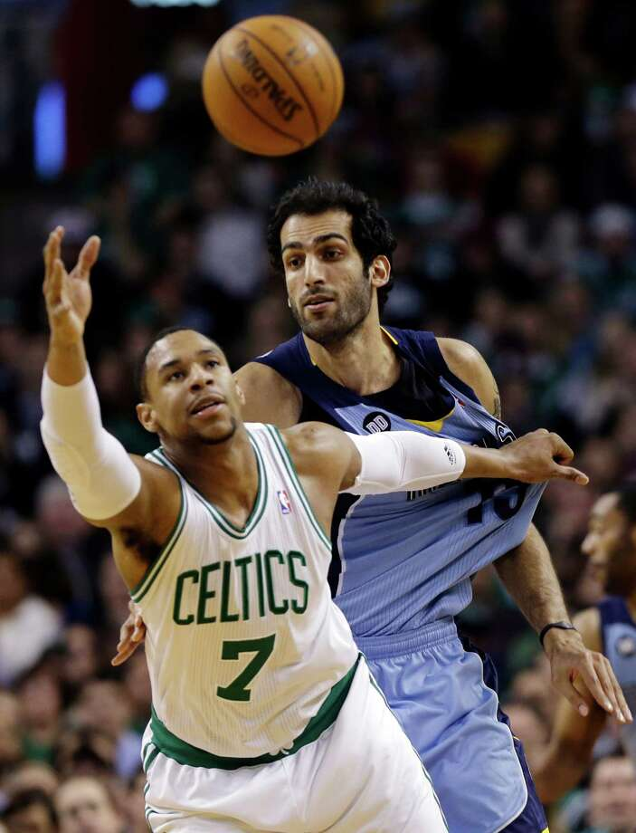 Boston Celtics forward Jared Sullinger (7) tries to control the ball against Memphis Grizzlies center Hamed Haddadi (15) during the second half of an NBA basketball game in Boston, Wednesday, Jan. 2, 2013. The Grizzlies won 93-83. (AP Photo/Elise Amendola) Photo: Elise Amendola