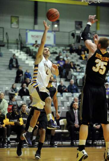UAlbany's Jacob Iati goes in for a basket during their men's college basketball game against UMBC at