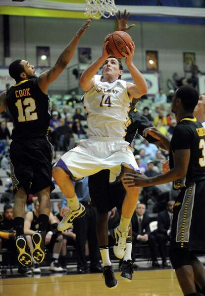 UAlbany's Sam Rowley goes to the basket during their men's college basketball game against UMBC at t