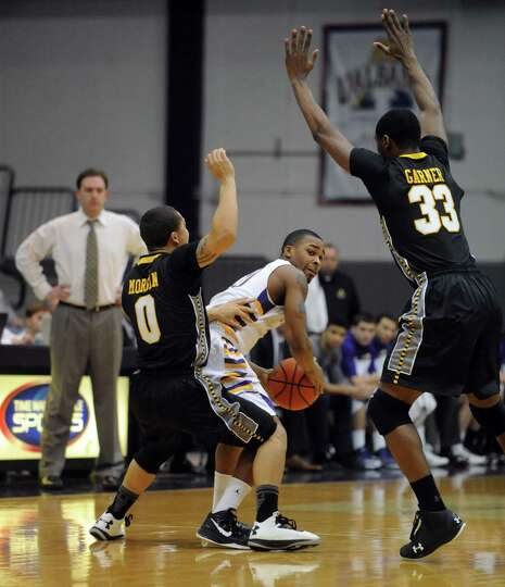 UAlbany's Mike black looks for an open man during their men's college basketball game against UMBC a