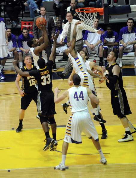 UAlbany's Jayson Guerrier goes to the basket during their men's college basketball game against UMBC