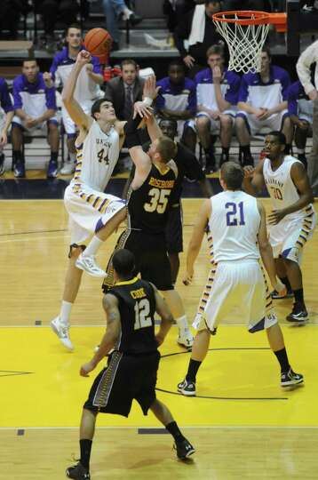 UAlbany's John Puk goes to the basket during their men's college basketball game against UMBC at the