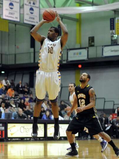 UAlbany's Jayson Guerrier takes a shot during their men's college basketball game against UMBC at th