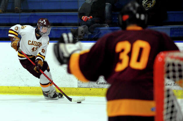 St. Joseph's #43 Dominick Sidorczuk moves the puck towards South Windsor's goallie Aidan Cain, during boys hockey action at The Rinks in Shelton, Conn. on Wednesday January 2, 2012. Photo: Christian Abraham / Connecticut Post