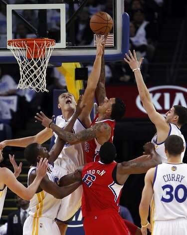 Andris Biedrins tries to block a shot by Matt Barnes in the first half of the game. The Warriors played the Los Angeles Clippers at Oracle Arena in Oakland, Calif., on Wednesday, January 2, 2013. Photo: Carlos Avila Gonzalez, The Chronicle