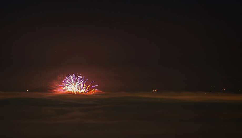 A view of fireworks rising above clouds and fog, during New Year's celebrations, early on January 1, 2012, as seen from Smarna Gora, the highest hill in Ljubljana. Photo: Jure Makovec, AFP/Getty Images