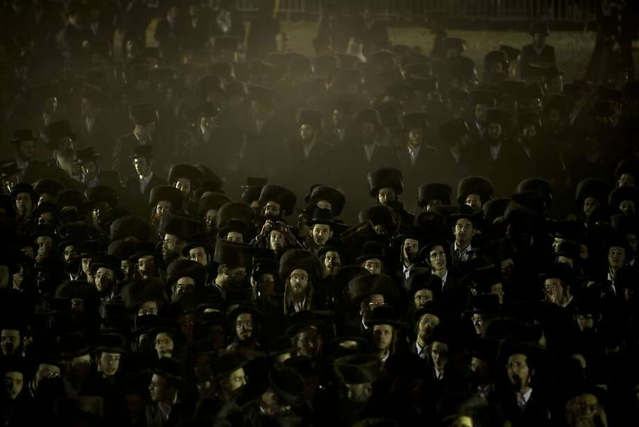 Ultra-Orthodox Jews gather in the men's section for a traditional Jewish wedding of the great-grandson of the Rabbi of the Sanz Hasidic dynasty, in Netanya, Israel, Wednesday, Jan. 2, 2013. Thousands of people attended the wedding. Photo: Oded Balilty, Associated Press