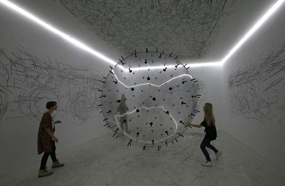 "Visitors look at an exhibit on display during the opening of ""Art Experiment"" exhibition at the Garage Center for Contemporary Cultures in Moscow's Gorky Park, Russia, Wednesday, Jan. 2, 2013.  The exhibition is sponsored by the British Council. Photo: Mikhail Metzel, Associated Press"