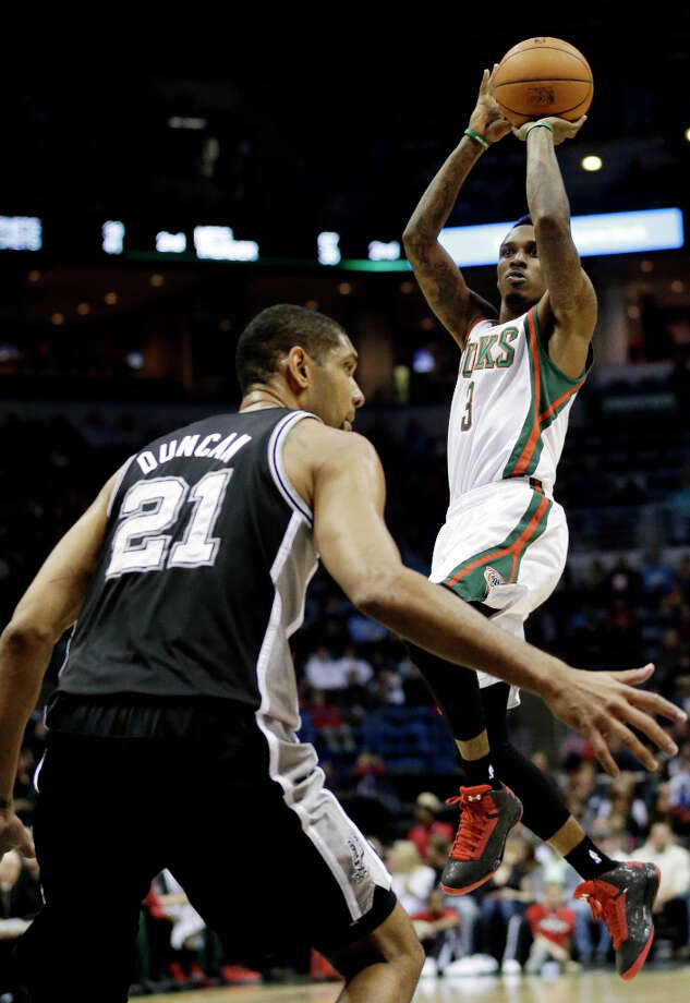 Milwaukee Bucks' Brandon Jennings (3) shoots over San Antonio Spurs' Tim Duncan (21) during the first half of an NBA basketball game on Wednesday, Jan. 2, 2013, in Milwaukee. Photo: Morry Gash, Associated Press / AP