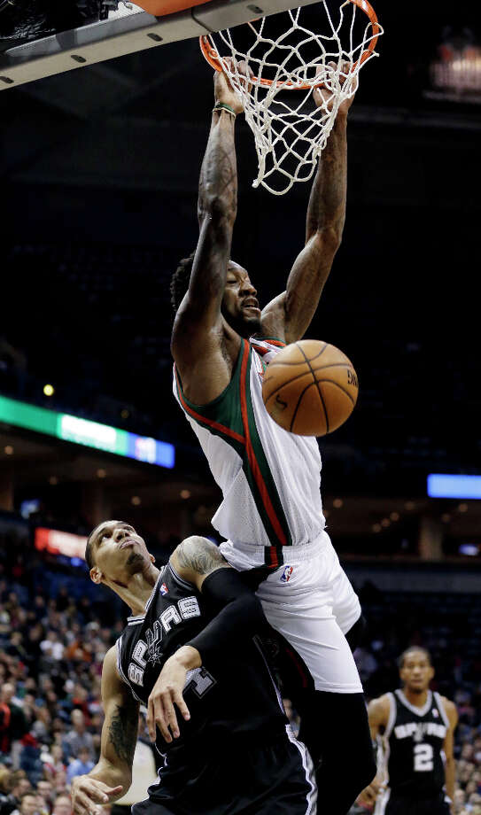 Milwaukee Bucks' Larry Sanders, top, dunks over San Antonio Spurs' Danny Green during the first half of an NBA basketball game on Wednesday, Jan. 2, 2013, in Milwaukee. Photo: Morry Gash, Associated Press / AP