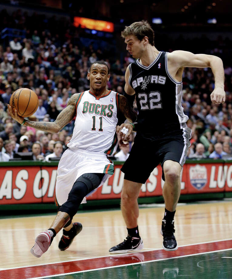 Milwaukee Bucks' Monta Ellis (11) goes up for a shot against San Antonio Spurs' Tiago Splitter (22) during the first half of an NBA basketball game on Wednesday, Jan. 2, 2013, in Milwaukee. Photo: Morry Gash, Associated Press / AP