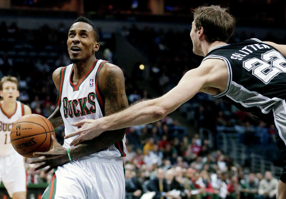 Milwaukee Bucks' Brandon Jennings is fouled by San Antonio Spurs' Tiago Splitter (22) as he goes up for a shot during the first half of an NBA basketball game on Wednesday, Jan. 2, 2013, in Milwaukee. Photo: Morry Gash, Associated Press / AP