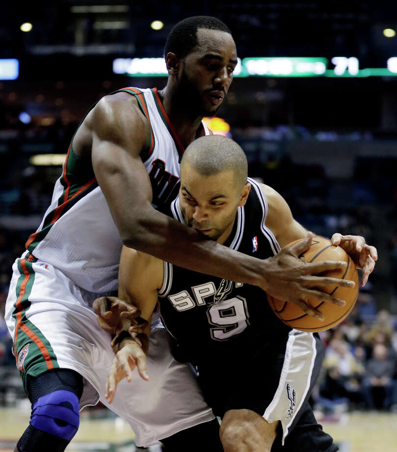 San Antonio Spurs' Tony Parker (9) tries to drive past Milwaukee Bucks' Luc Richard Mbah a Moute during the second half of an NBA basketball game on Wednesday, Jan. 2, 2013, in Milwaukee. Photo: Morry Gash, Associated Press / AP