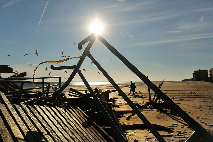 The remains of part of the boardwalk lie along the beach in the Rockaways on January 2, 2013 in the