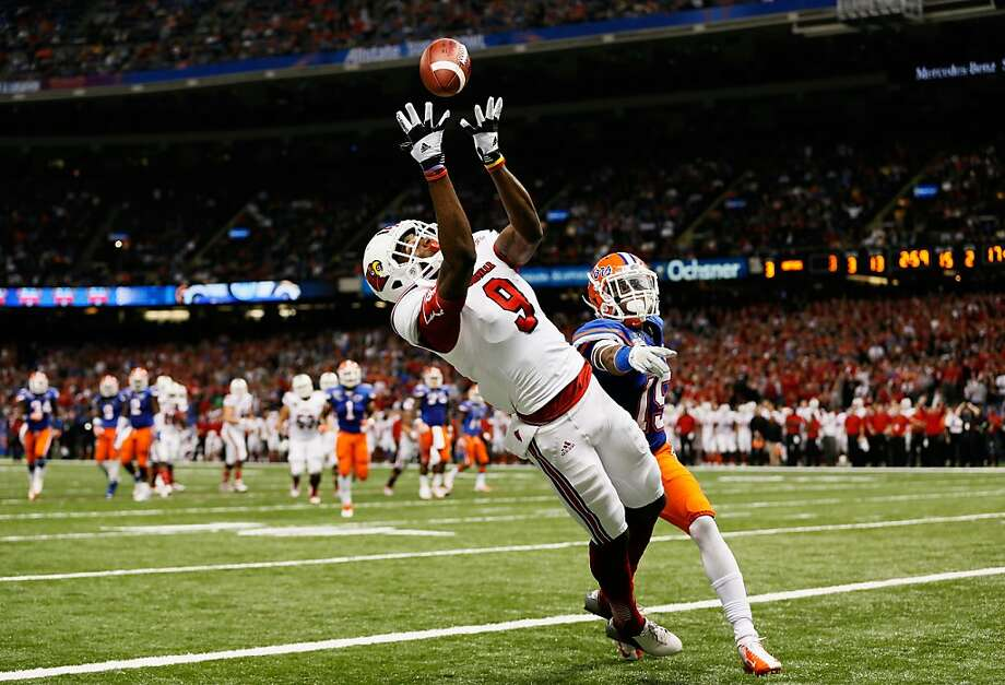 DeVante Parker #9 of the Louisville Cardinals catches a second quarter touchdown pass over Loucheiz Purifoy #15 of the Florida Gators during the Allstate Sugar Bowl at Mercedes-Benz Superdome on January 2, 2013 in New Orleans, Louisiana. Photo: Kevin C. Cox, Getty Images