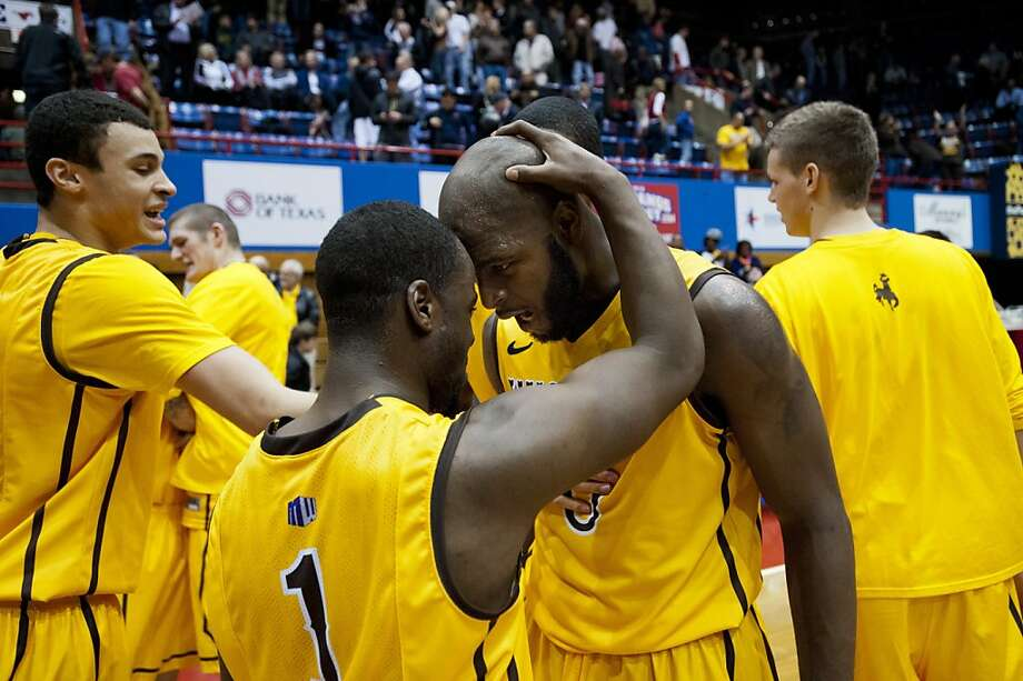 Derrious Gilmore #1 and Leonard Washington #0 of the Wyoming Cowboys celebrate after defeating the SMU Mustangs on January 2, 2013 at the Moody Coliseum in Dallas, Texas. Photo: Cooper Neill, Getty Images