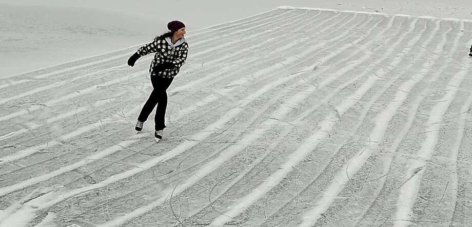 Sixteen-year-old Emma Burke of Coeur d'Alene glides across a frozen Fernan Lake on Wednesday, Jan. 2, 2013, in Coeur d'Alene, Idaho. Photo: Kathy Plonka, Associated Press