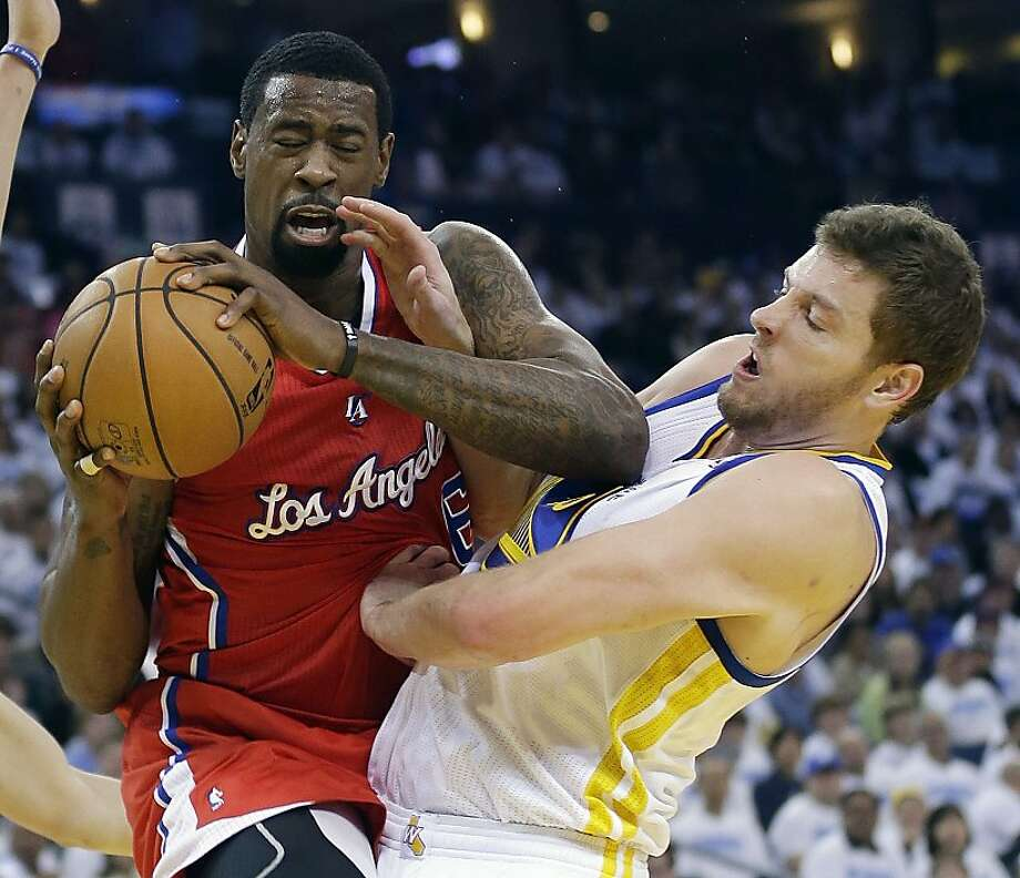 Los Angeles Clippers' DeAndre Jordan (6) grabs a rebound next to Golden State Warriors' David Lee during the first half of an NBA basketball game in Oakland, Calif., Wednesday, Jan. 2, 2013. (AP Photo/Marcio Jose Sanchez) Photo: Marcio Jose Sanchez, Associated Press