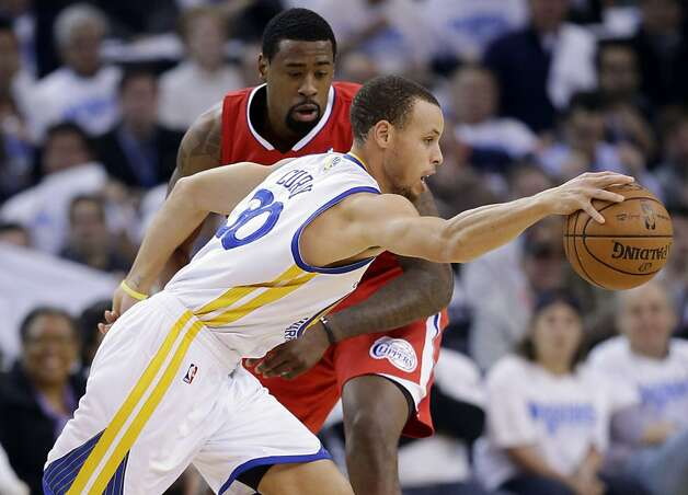 Golden State Warriors' Stephen Curry (30) dribbles around Los Angeles Clippers' DeAndre Jordan during the first half of an NBA basketball game in Oakland, Calif., Wednesday, Jan. 2, 2013. (AP Photo/Marcio Jose Sanchez) Photo: Marcio Jose Sanchez, Associated Press