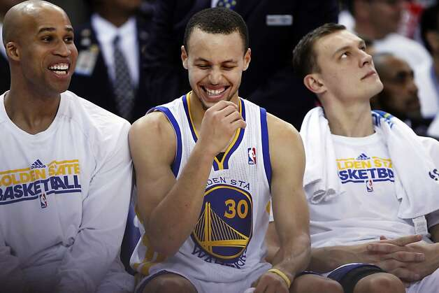 Stephen Curry was in a nice position to laugh after coming out of the game in the fourth quarter, having scored 31 points. Photo: Carlos Avila Gonzalez, The Chronicle