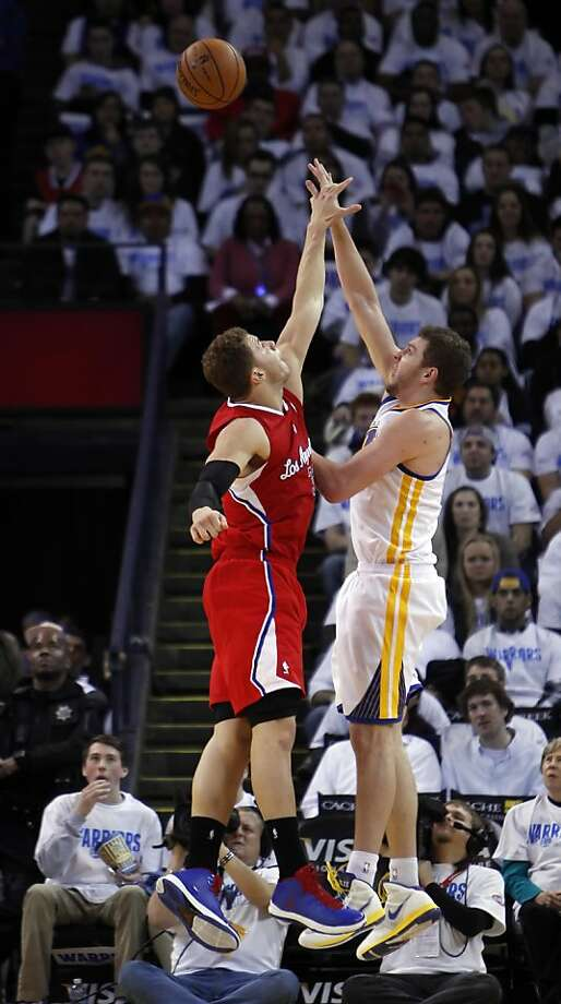Blake Griffin tries to block a shot by David Lee in the fourth quarter of the game. The Warriors played the Los Angeles Clippers at Oracle Arena in Oakland, Calif., on Wednesday, January 2, 2013. Photo: Carlos Avila Gonzalez, The Chronicle