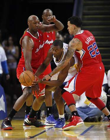 Harrison Barnes is pressured in the fourth quarter by Lamar Odom, left, and Matt Barnes. The Warriors played the Los Angeles Clippers at Oracle Arena in Oakland, Calif., on Wednesday, January 2, 2013. Photo: Carlos Avila Gonzalez, The Chronicle