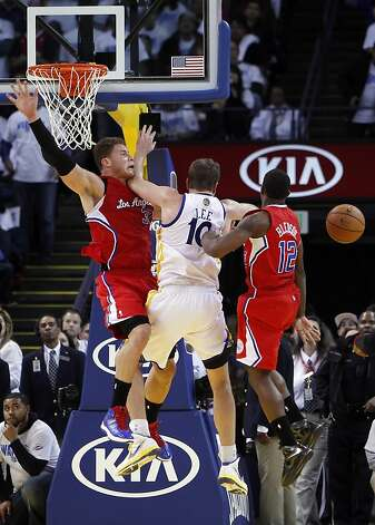 David Lee is fouled by Blake Griffin in the third quarter of the game. The Warriors played the Los Angeles Clippers at Oracle Arena in Oakland, Calif., on Wednesday, January 2, 2013. Photo: Carlos Avila Gonzalez, The Chronicle