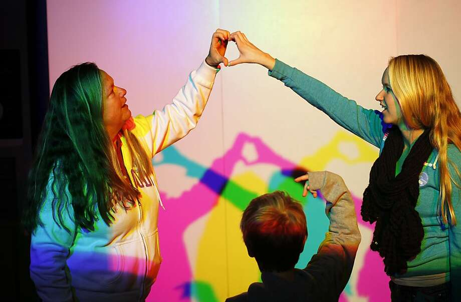 Lori Dorsey, left, and her daughter Taylor, 18, right, of Pleasanton, try to make a heart shadow on the last day the Exploratorium is open in San Francisco, Calif., Wednesday, January 2, 2013.  After Wednesday the Exploratorium will be closed while it moves to its new location at Pier 15. Photo: Sarah Rice, Special To The Chronicle