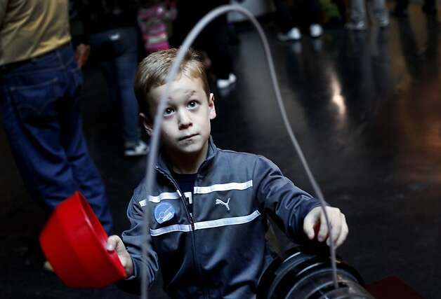 Zachary Langford, 6, of Sacramento, plays with one of the exhibits on the last day the Exploratorium is open in San Francisco, Calif., Wednesday, January 2, 2013.  After Wednesday the Exploratorium will be closed while it moves to its new location at Pier 15. Photo: Sarah Rice, Special To The Chronicle