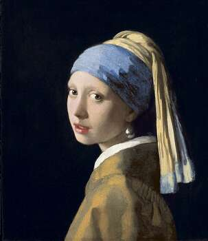 """Jan. 26: """"Girl With a Pearl Earring,"""" Johannes Vermeer's enigmatic masterpiece, kicks off its North American tour at the de Young, headlining a collection of Dutch paintings from the Royal Picture Gallery Mauritshuis. Museum visitors cluster around the 18-by-16-inch work, captivated by the mysterious pearl-adorned beauty often referred to as the Dutch Mona Lisa. Photo: Royal Picture Gallery Mauritshui"""
