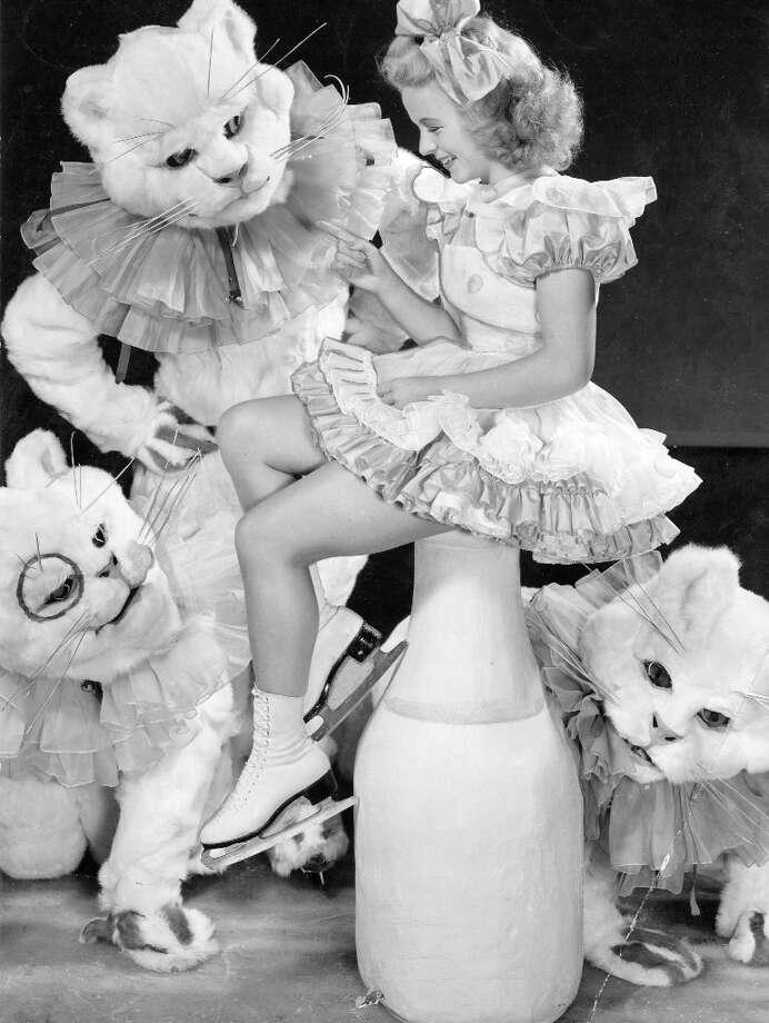 A promotional still for the Ice Follies in 1942. I'm convinced this is what we would have seen if Stanley Kubrick directed a 1998 stage production of Cats. As creepy as the cat on the lower left is, I'm still a little more disturbed by the position of the milk bottle. Photo: Courtesy Ice Follies / ONLINE_YES