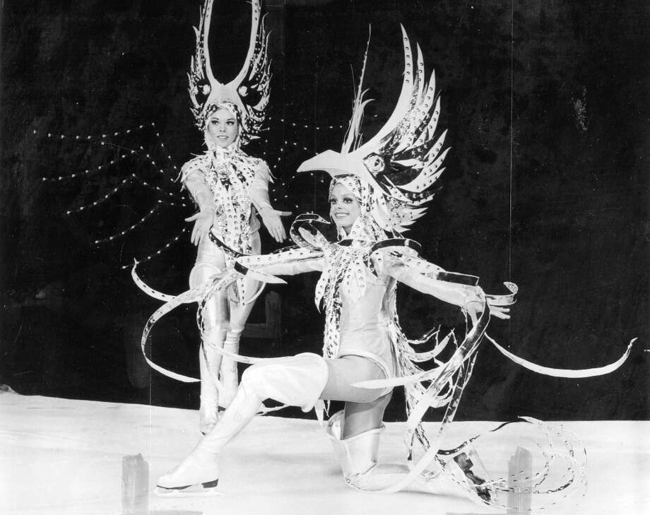 Two Ice Capades performers in 1972. The attached press release explains: Beautiful bird girls perch on the surface of frozen fantasy as all the elements of the unusual take you to Atlantis. Just once in my life I'd like to write a sentence that awesome. Photo: Courtesy Ice Capades / ONLINE_YES