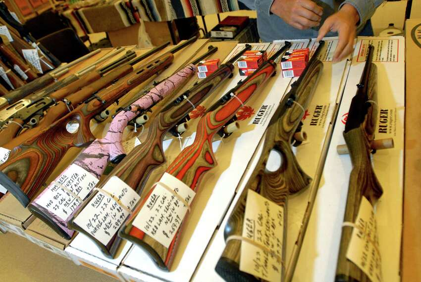Specialty 22-caliber rifles are on display for the Arms Fair on Friday, Aug. 28, 2009, at the City Center in Saratoga Spring, N.Y. (Cindy Schultz / Times Union)