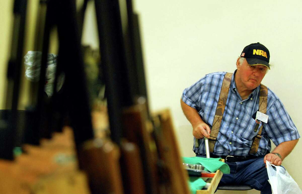 Gun enthusiast Joel Konieczny of Watervliet helps his friend set up for the Arms Fair on Friday, Aug. 28, 2009, at the City Center in Saratoga Spring, N.Y. (Cindy Schultz / Times Union)