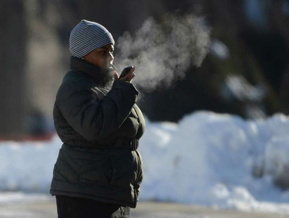 As a person talks on her cell phone in the air cold her breath forms a cloud Tuesday morning Jan. 3, 2013, on Washington Avenue in Albany, N.Y. (Skip Dickstein/Times Union) Photo: SKIP DICKSTEIN