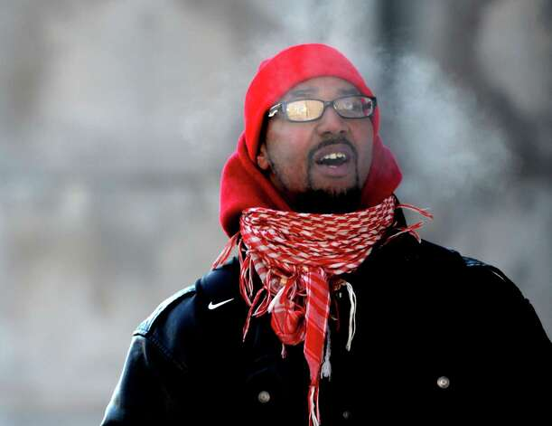 Shaheed Addison shows the cold as his breath turns to a cloud on Washington Avenue Tuesday morning Jan. 3, 2013, in Albany, N.Y. Jan 2, 2013. (Skip Dickstein/Times Union) Photo: SKIP DICKSTEIN