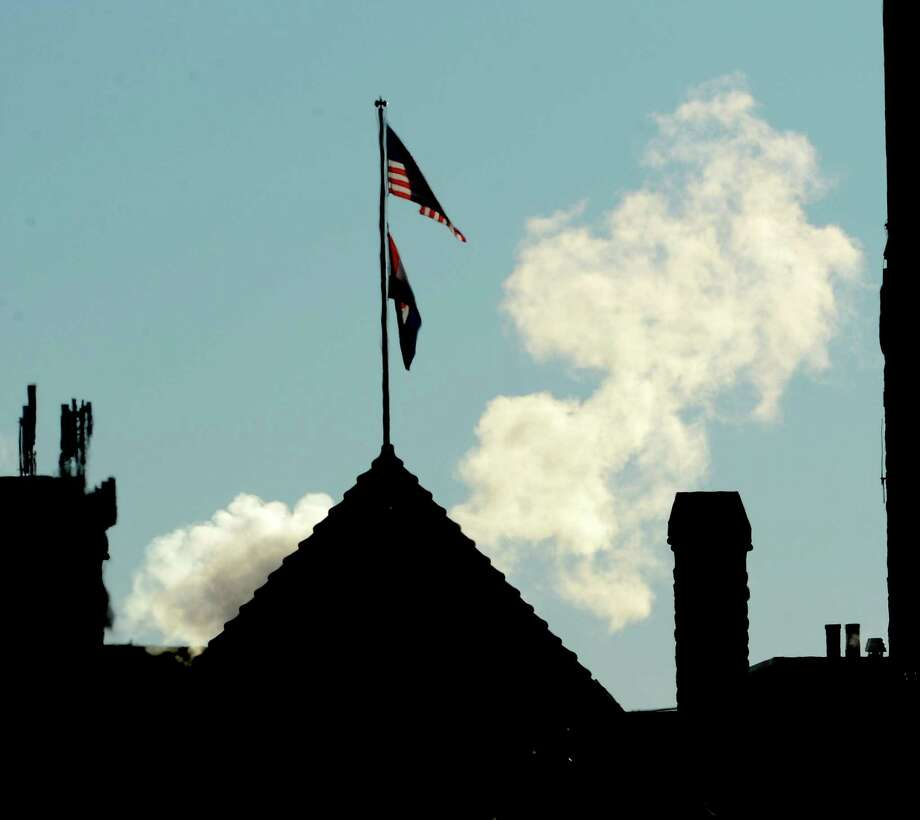 Clouds of steam rear up behind Albany City Hall Tuesday morning Jan. 3, 2013, in Albany, N.Y. (Skip Dickstein/Times Union) Photo: SKIP DICKSTEIN