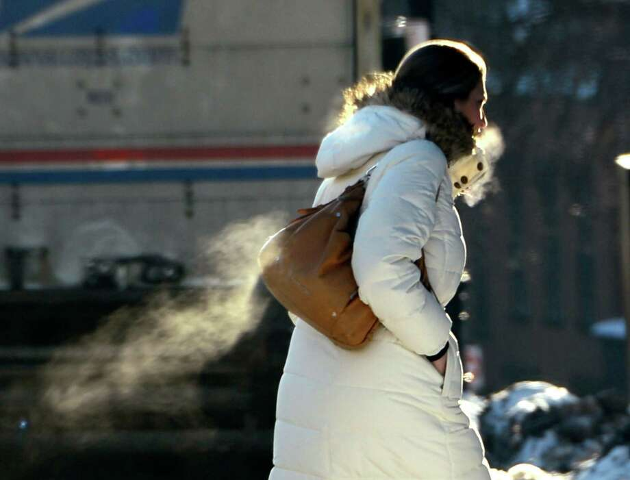 The chill in the air is shown as this person crosses Washington Avenue Tuesday morning Jan. 3, 2013, in Albany, N.Y.  (Skip Dickstein/Times Union) Photo: SKIP DICKSTEIN
