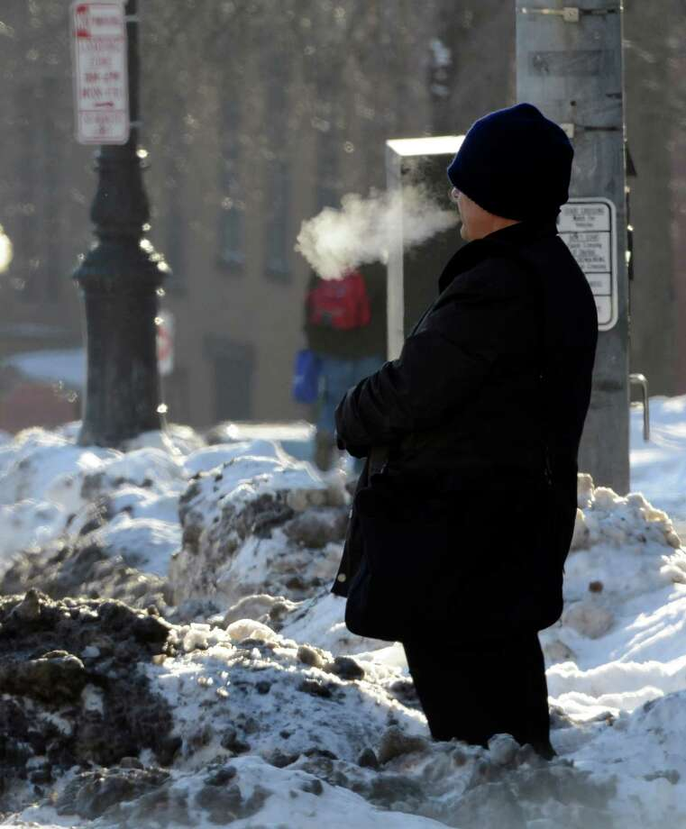 A person waits for the bus in the extreme on Washington Avenue Tuesday morning Jan. 3, 2013, in Albany, N.Y. (Skip Dickstein/Times Union) Photo: SKIP DICKSTEIN