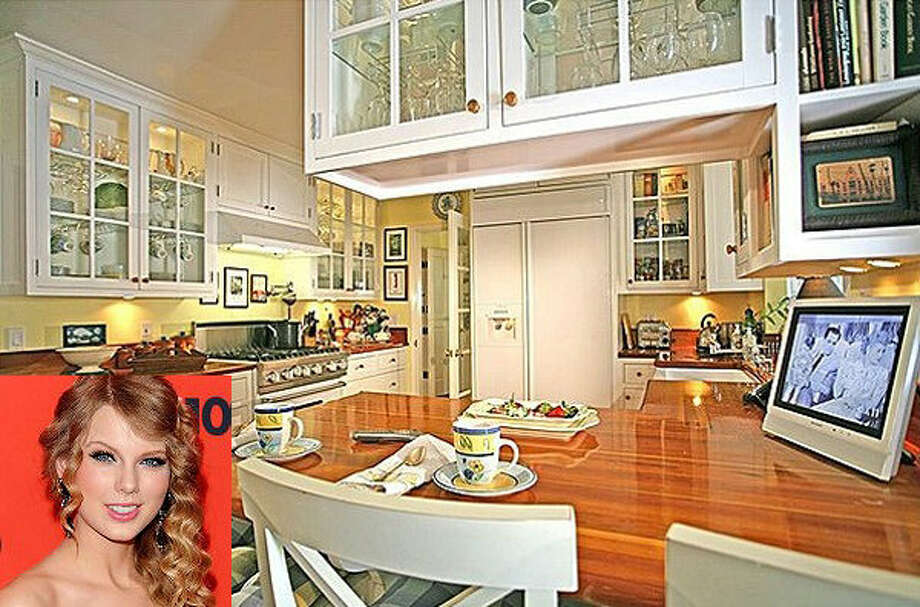 Taylor Swift's kitchen- all shiny and new, like her rise to fame! Photo via Zillow and IMBD.